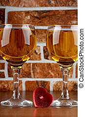 Two glass and stones wall - Glass and bottle wine on wooden...