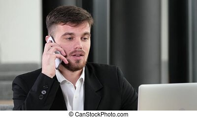 Office worker made a deal talking on a mobile phone, young...