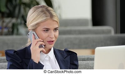 Attractive businesswoman smiling talking on a cell phone,...
