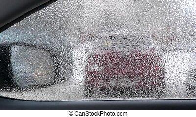 Frozen window of car in winter pan