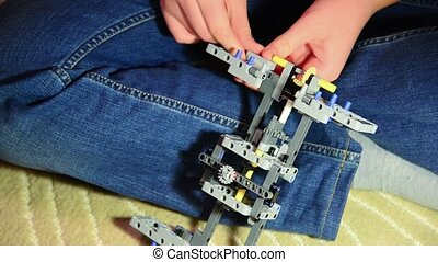 Teen boy collects car constructor - A Teen boy collects a...