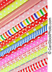 Rolls of wrapping paper - Cheerful background made from...