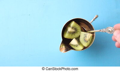 Some fresh Kiwi Fruits. Food background. Top view Copy...
