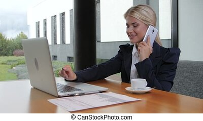 Woman office worker holds important talks on the phone -...
