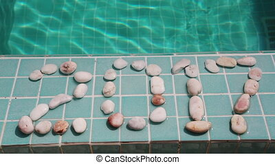 Inscription 2017 of pebble on a pool side,