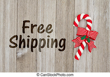 Christmas free shipping message, A red and white candy cane...