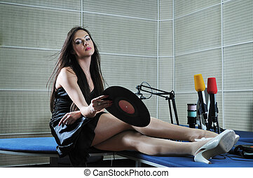 woman posing in the music studio - happy young fashion woman...