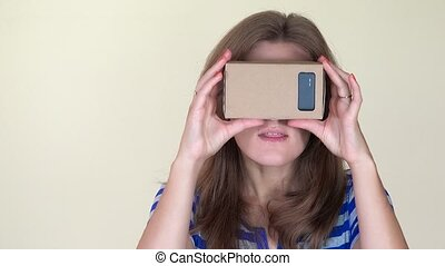 Emotional woman using virtual glasses. Girl touching air and...