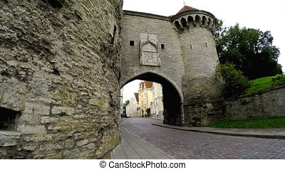 Old city in Tallinn, Estonia. Big Sea gate and tower Fat...