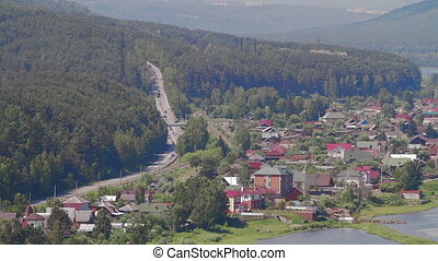 Scenic view from high mountain river Cityscape - Summer...
