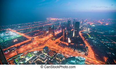 Dubai Downtown sunrise timelapse and view from the rooftop in Dubai