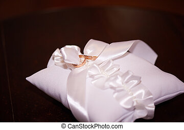 wedding rings on a white pillow - bridal wedding rings on a...