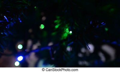 out-of-focus. Flashing different colors of garland at a...