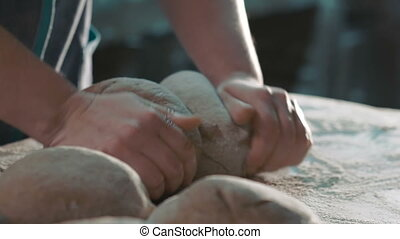 Woman kneading rye dough on table. Full HD