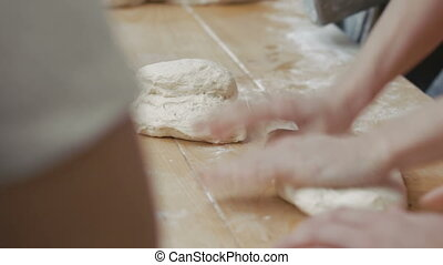 Women kneading rye dough for bread on table. Full HD
