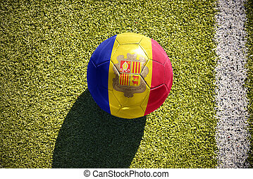 football ball with the national flag of andorra lies on the...
