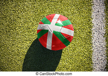 football ball with the national flag of basque country lies...