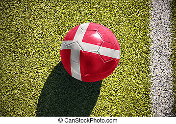football ball with the national flag of denmark lies on the...