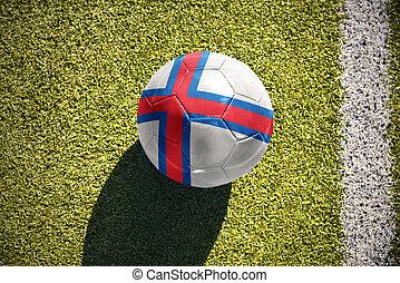 football ball with the national flag of faroe islands lies...