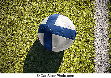 football ball with the national flag of finland lies on the...