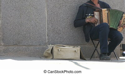Man aged 60s plays accordion in summer outdoors - Man...