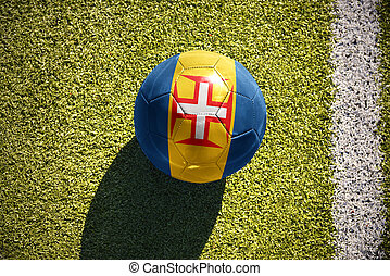 football ball with the national flag of madeira lies on the...