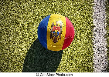 football ball with the national flag of moldova lies on the...