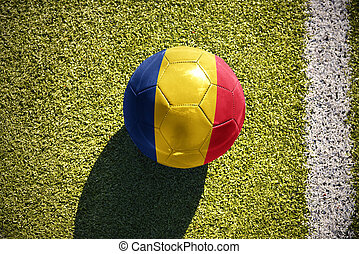 football ball with the national flag of romania lies on the...