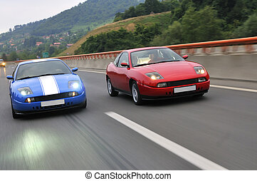 Tuning cars sacing down the highway - Two hot tuning cars...