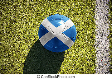 football ball with the national flag of scotland lies on the...