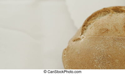 Close up of wheat bread on the white background. Full HD