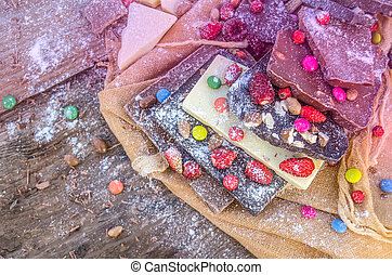hocolate mix with colorful candy and fruit - Chocolate...