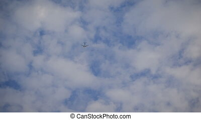 Plane is flying at a high altitude in the sky. Aircraft...