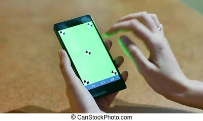 womans hands using a Smart phone Touchscreen CHROMA KEY Close-up , Fingers make gestures touching and swiping the screen of a modern smartphone.