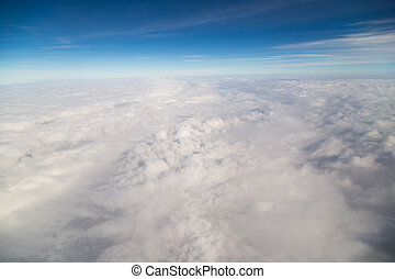 blue sky high view from airplane clouds shapes
