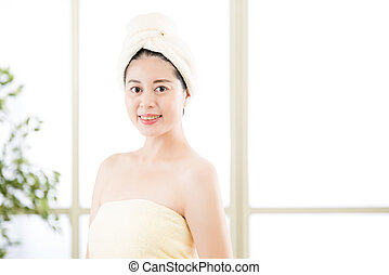 charming asian woman drying towel on head after shower -...