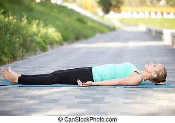 Dead Body exercise - Sporty attractive young woman...