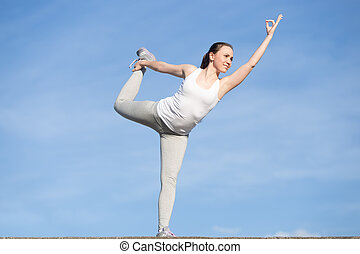Girl standing in Lord of the Dance exercise - Sporty young...