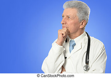 mature male doctor - Portrait of a mature male doctor in...