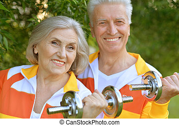 mature couple working out - Portrait of a mature couple...