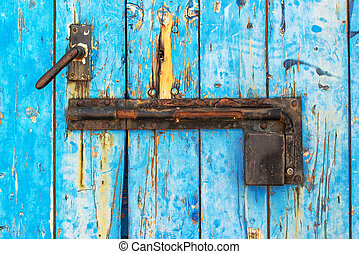 Rustic wooden door with metal lock