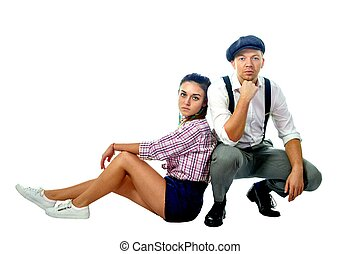 Image of a young man in a cap and woman in shorts