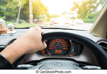 driver eye view  with hand on wheel