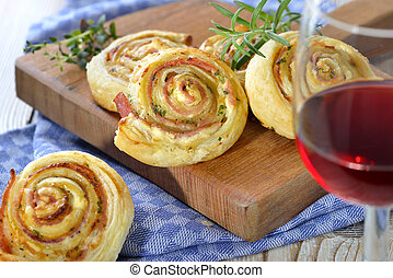 Puff pastry rolls with ham and cheese