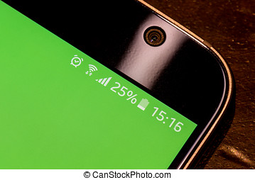 Smartphone with twenty five percent battery charge on the...