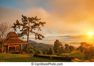 Huai Nam Dang National Park - Morning sunrise over mist with...