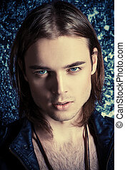 casanova look - Fashion shot. Handsome sexual young man in...