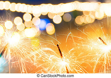 sparkler with bokeh de focused blurred background,New year...