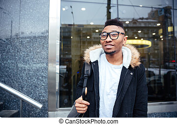 Cheerful african young man walking on the street - Image of...