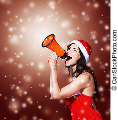 beautiful girl in costume of Santa Claus with a megaphone at...